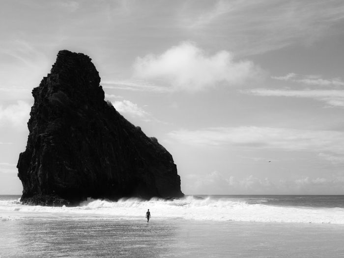 Black And White Sea Sky Land Water Beach Beauty In Nature Scenics - Nature Tranquility One Person Rock Incidental People Go Higher