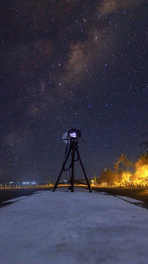 Satellite against sky at night