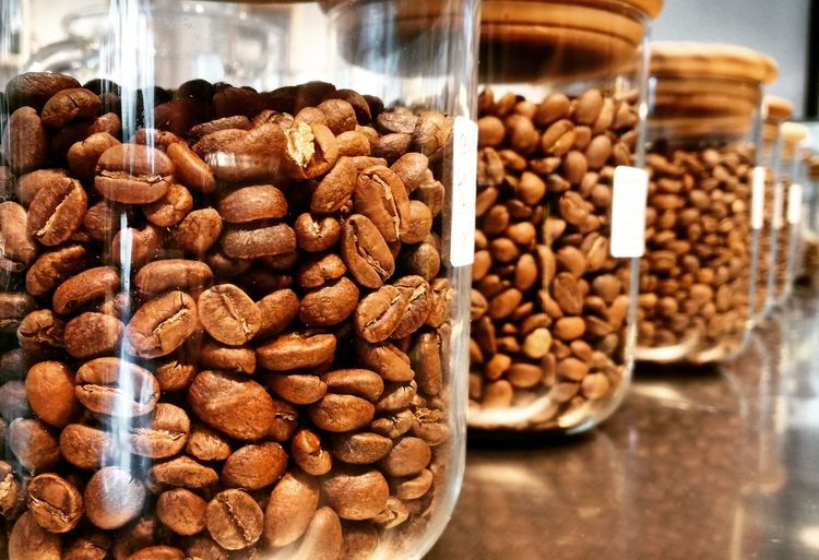 Jugs of roasted beans Cafe Coffee Beans Coffee Beans Jug Supermarket Unroasted Fresh Roasted Roasted Coffee Bean