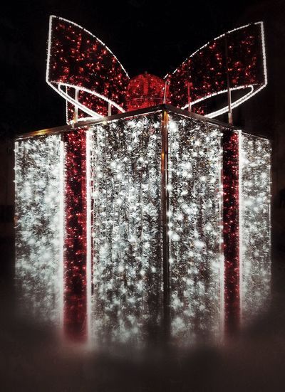 Close-up of christmas decorations over black background