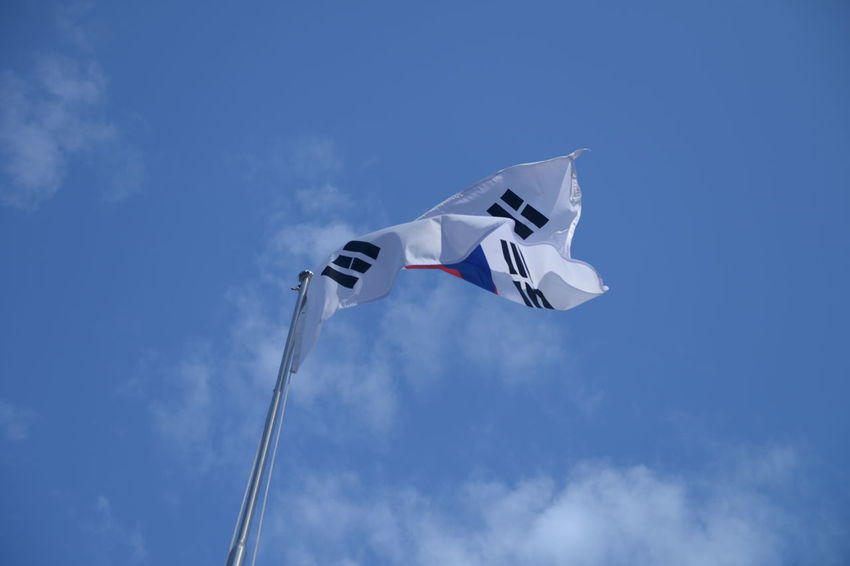 Sky Low Angle View Flag Patriotism Cloud - Sky Blue Wind Nature Environment No People Day Waving Pole White Color Outdoors Motion National Icon Flying Freedom Independence Korean Flag