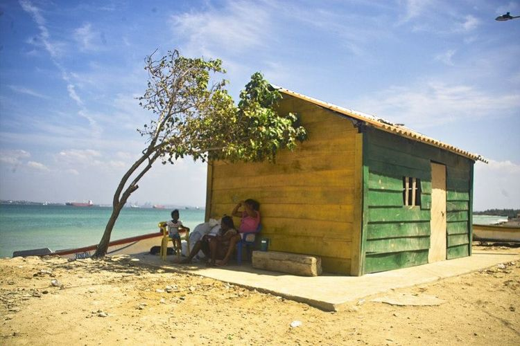 Architecture Beach Beach Life Beach Photography Building Exterior Built Structure Cartagena, Colombia Day House Nature No People Outdoors Summer Sunny Tree Tree Trunk Tropical Climate Vacation Vacations Weekend Activities Wood People Of The Oceans