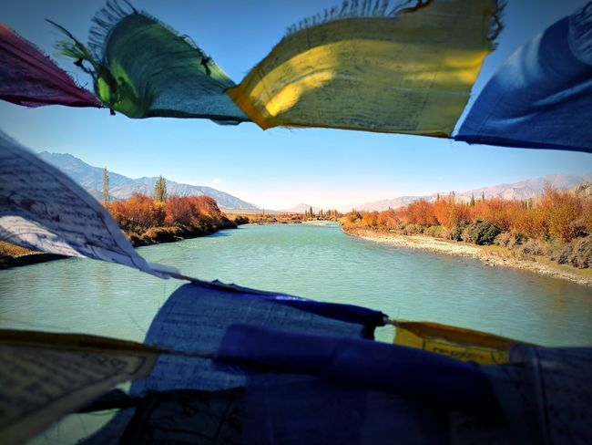 Mountain Water No People River Outdoors Day Nature Sky Indus River Prayer Flags  Bridge View Bridge Over The River Multi Colored Poplar Trees Buddhism Buddhist Culture Be. Ready. Perspectives On Nature