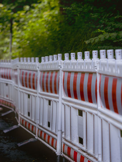 Row of red railing by fence