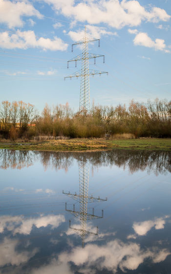 Cloud - Sky Water Sky Reflection No People Nature Technology Day Lake Outdoors Communication Connection Tranquility Tranquil Scene Waterfront Beauty In Nature Antenna - Aerial Symmetry Power Line  Energy Industry