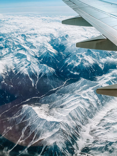 Aerial view of sea and snowcapped mountain