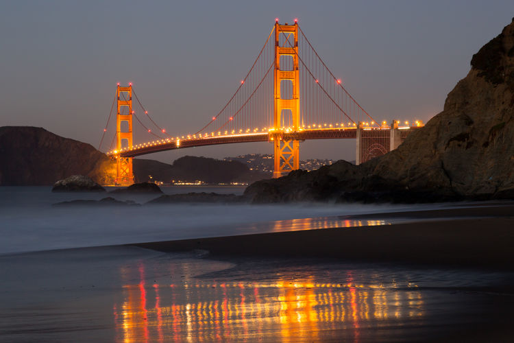 Illuminated golden gate bridge over san francisco bay at night