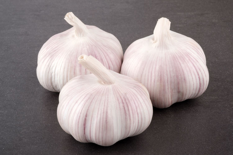 Garlic Closeup Isolated Ripe Nobody Natural Spice Green White Organic Bulb Life Leaf Flavor Vitamins Aromatic Condiment Meals Vegetable Clove Three Pink Object Healthy Still Group Plant Spiciness Seasoning Ingredient Part Fruit Fresh Nutrition Spicy Harvest Food Eating Parsley