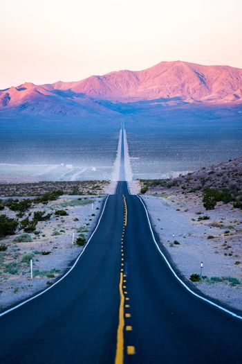 Road Scenics The Way Forward Landscape Travel Mountain Remote Straight Transportation Beauty In Nature Nature Tranquil Scene Journey Mountain Range Travel Destinations Tranquility Outdoors Desert Sunset Day Beatty