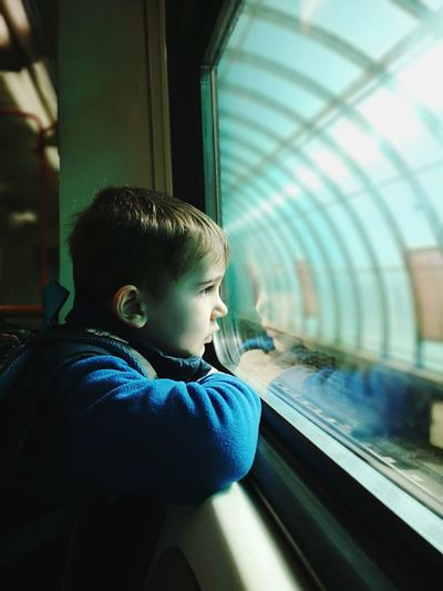 Looking through the window Looking Through Window Backgrounds Oneboyonly Mobilephotography Beautiful Copy Space Light Stockphoto Huaweip20pro Stockimage Childhood Child Boys Playing Watching Train - Vehicle Railroad Track Sitting Tunnel Subway Train Railroad Station Platform Rail Transportation Train Railroad Station Public Transportation