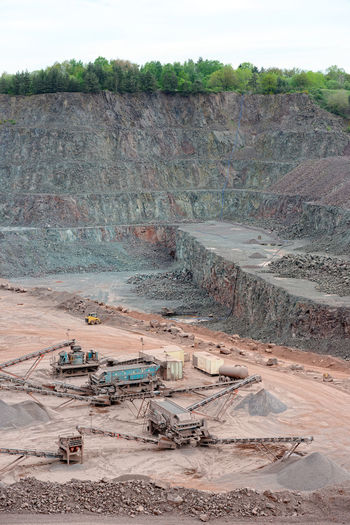 stone crusher in a quarry. mining industry Driving Loading Minerals Mining Quarry Quarry Rock Stonepit Rocks Steinbruch Construction Material Construction Materials Production Stone Pit Transportation Surface Mine Mine Conveyor Belt Stone Crusher Steinbrecher