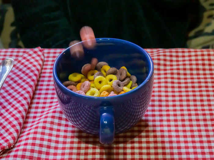 Cereal Breakfast Food Sweet Food Sweet Motion Stop Motion Motion Capture Dessert Temptation Indulgence Obesity Diabetes Diabetic Sugar Color Cereals American Cereal Cereals Snack Meal Morning Healthy Eating Lifestyles Still Life Round Shape Crunchy Nutrition Health Fruity Natural Flakes Corn Flakes Cornflakes Carbohydrate - Food Type Carbohydrates Childhood Calories Multicolors  Organic Mug Falling Down color palette Fruit Loops Loop Wellbeing Food And Drink Checked Pattern Bowl Fruit Tablecloth Freshness Kitchen Utensil Table Focus On Foreground No People High Angle View Day Close-up Eating Utensil Spoon Ready-to-eat Indoors