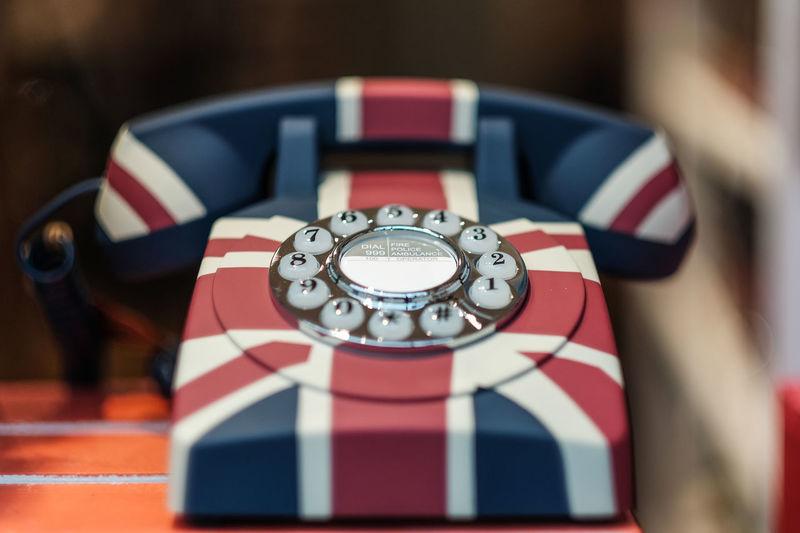 Close-up of british retro telephone on table