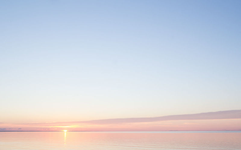 Baltic Sea Beach Beauty In Nature Blue Calm Horizon Over Water Idyllic Lativia Majestic Nature No People Non-urban Scene Ocean Orange Outdoors Pink Remote Scenics Seascape Sky Sunburst Sunset Tranquil Scene Tranquility Water