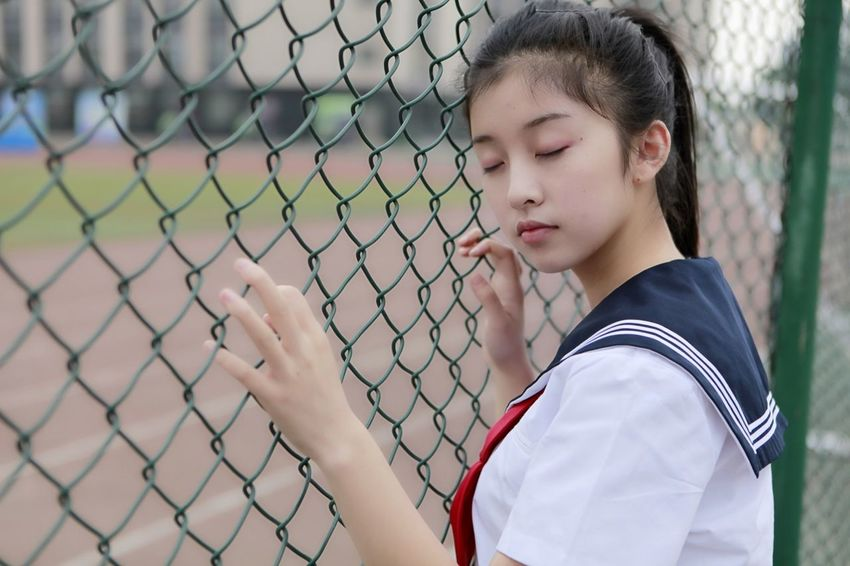Chainlink Fence Baseball - Sport One Person Outdoors Child Watching Day Standing Competition Childhood Sport Team Sport People Playing Field Children Only Nature Baseball Helmet