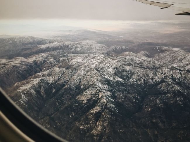 Snowy mountains by Los Angeles Mountain Landscape Scenics Nature Beauty In Nature Aerial View Tranquil Scene Tranquility Mountain Range Day Physical Geography Dramatic Landscape Outdoors No People Awe Airplane View Into Land Sky Mountain Ridge Airplane Wing Los Angeles, California California