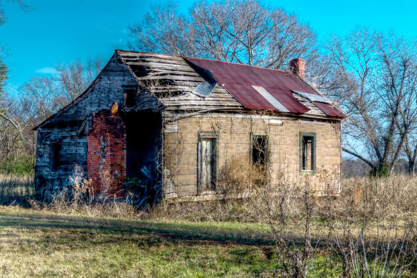 Abandoned Architecture Bad Condition Blue Building Exterior Built Structure Day Field Grass History House Landscape Nature No People Obsolete Old Old-fashioned Outdoors Rural Scene Sky Tree Weathered