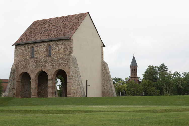 monastery Lorsch Hessen Lorsch Monastery Of Stone Architecture Belief Building Building Exterior Built Structure Day Field Grass History Monastery Lorsch Hessen Monastery Garden Monastery Ruin Nature No People Outdoors Place Of Worship Plant Religion Sky Spire  Spirituality The Past Tree