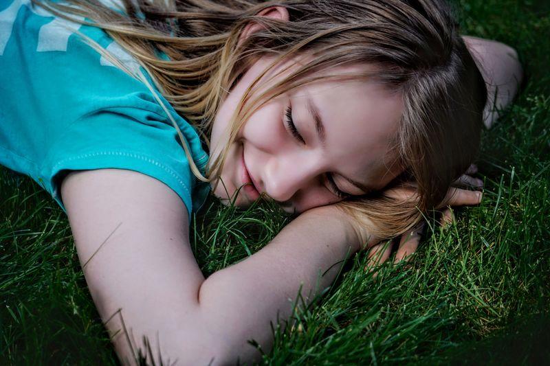 Girl lying down on field