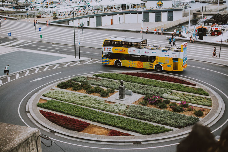 Transportation Mode Of Transportation City Land Vehicle High Angle View Street Road Marking Travel Madeira Madeira Island Portugal Europe Colorful Bus Roundabout Traffic Canon Shape Travel Destinations
