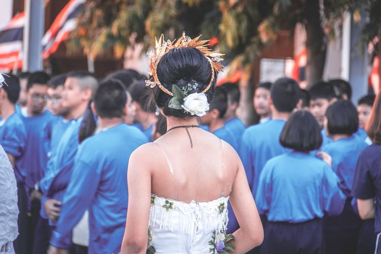 Girl wearing tiara with friends during celebration