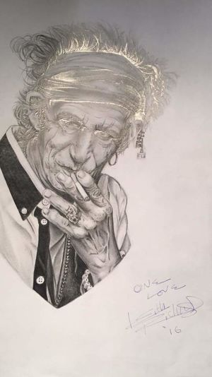 This was drawn by a friend. It was signed by the man in the photo!!