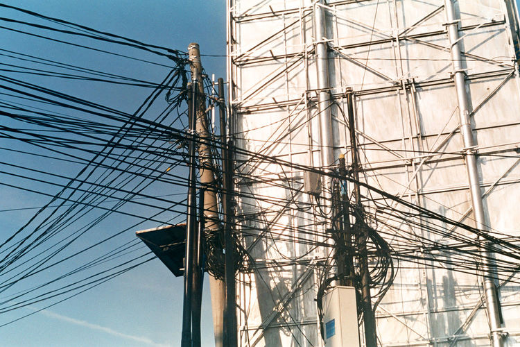 electric cables are complicated Streetphotography Analogue Photography Street INDONESIA Cirebon  35mm 35mm Film Film Film Photography Filmisnotdead EyeEmNewHere Cable Electricity  Power Line  Electricity Pylon Power Supply Connection Fuel And Power Generation Complexity No People Technology Day Outdoors Low Angle View Sky Blue Above Industry Telephone Line Tall Ship