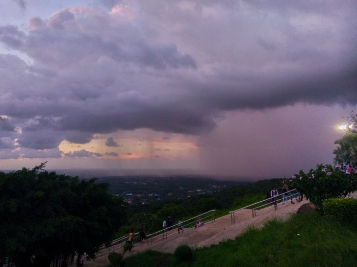 High angle view of storm clouds over road