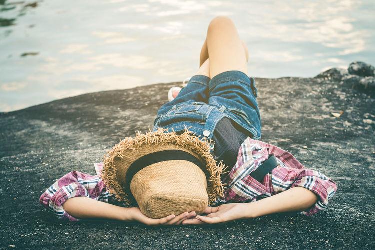 Woman Lying Down At Lake