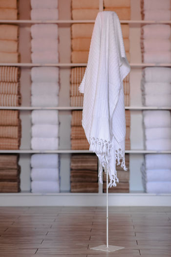Close-up of clothes hanging on floor at home