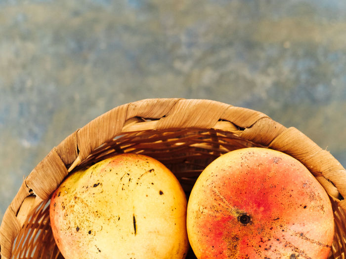 Close-up of mangoes in wicker basket