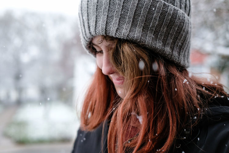 Close up of girl smiling in the snow