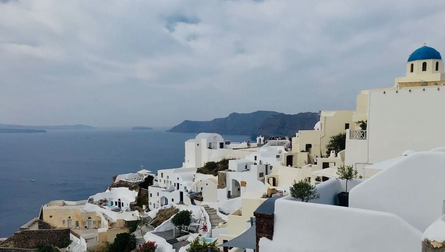 Panoramic view of buildings and sea against sky