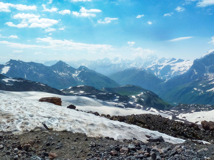 Snowy mountain landscape of Elbrus on a Sunny summer day. Glaciers and rocks. Mountain Beauty In Nature Sky Scenics - Nature Environment Tranquil Scene Tranquility Nature Day Snow Cold Temperature Snowcapped Mountain Summer Day No People Rock Landscape Cloud - Sky Non-urban Scene Mountain Range Solid Mountain Peak Glaciers Valley White Clouds Caucasus Mountains