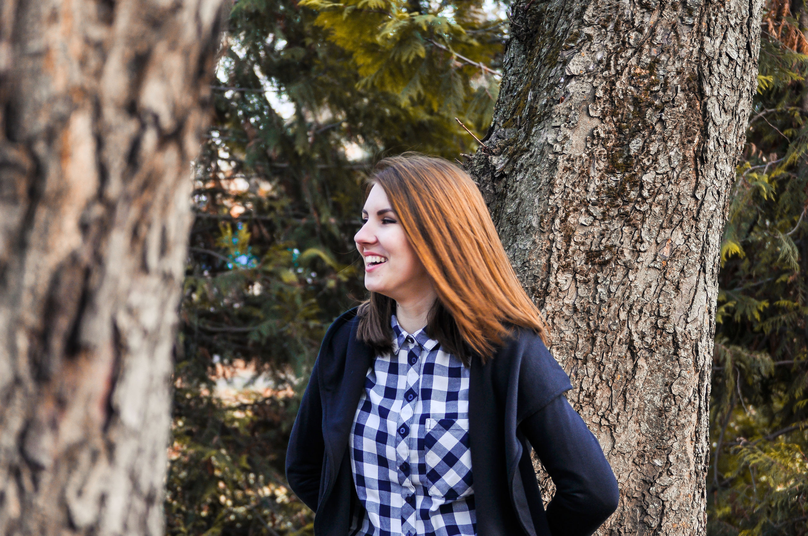 young adult, lifestyles, tree, leisure activity, young women, casual clothing, person, standing, long hair, three quarter length, waist up, forest, front view, tree trunk, focus on foreground, portrait, looking at camera