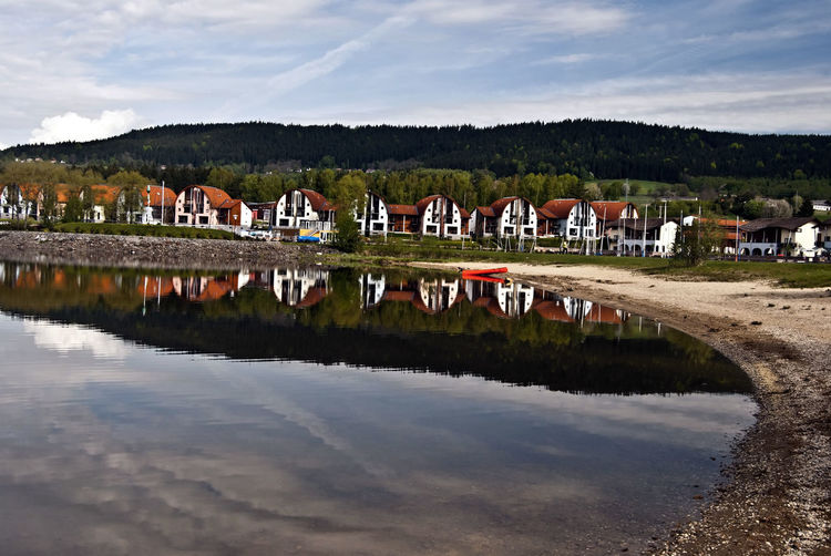 Lipno water reservoir with recreational houses reflected on its water ground in Czech republic Czech Republic Lipno Recreation  Travel Water Reflections Beach Building Cloud - Sky Landscape Nature Outdoors Recreation Area Reflection Sand Sand Beack Scenics Sky Tourism Travel Destination Vacation Water Water Reservoir