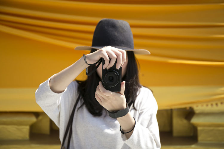 Woman photographing through camera