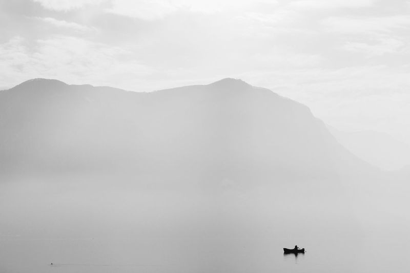 The KIOMI Collection Nature_collection Lugano, Switzerland Foggy Lake View Boat Black And White B&W Collection Blackandwhite Monochrome Silhouette Tranquil Scene Minimalist Minimalism Telling Stories Differently The Great Outdoors With Adobe On The Way Tranquility TakeoverContrast Monochrome Photography Miles Away Lugano, Switzerland. Welcome To Black Breathing Space