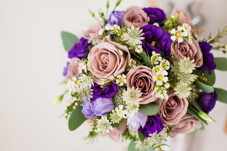Close-up of flower bouquet against white background