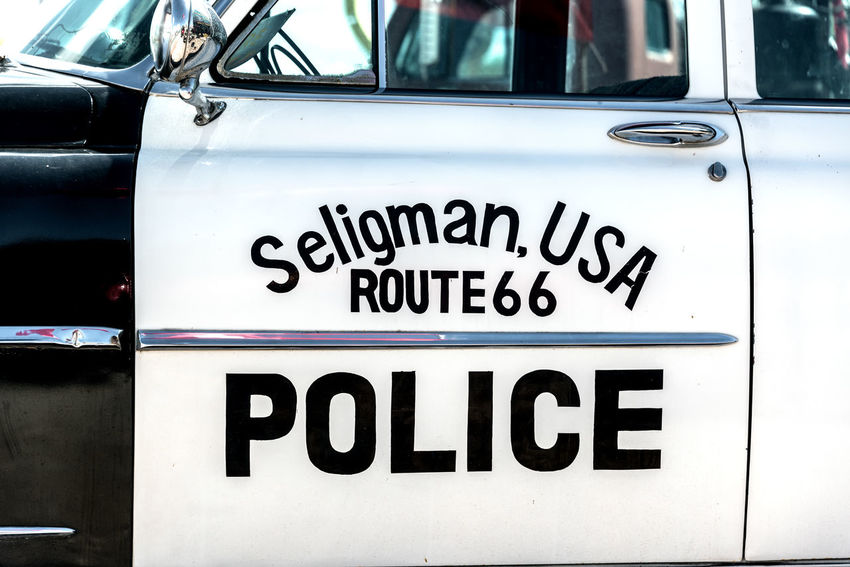 SELIGMAN, AZ - SEPTEMBER 16: Old police car in Seligman, AZ on Route 66 on September 16, 2015 Arizona Car Chrysler Classic Classic Car Day Highway Historic Land Vehicle Mode Of Transport New Yorker New Yorker Deluxe No People Outdoors Police Police Car Route Route 66 Seligman Text Tourism Transportation Transportation Travel Travel Destinations