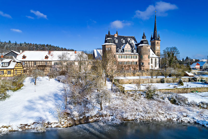 Air view of Ahorn castle in Coburg, Bavaria, Germany Ahorn, Air, Air View, Architecture, Bavarian, Birds Eye Perspective, Building, Castle, Cities, Coburg, Culture, Destinations, Europe, European, Germany, House, Palace, Rural, Snow, Street, Travel, Winter, Architecture Bare Tree Beauty In Nature Building Exterior Built Structure Cold Temperature Day Nature No People Outdoors Sky Snow Tree Weather Winter