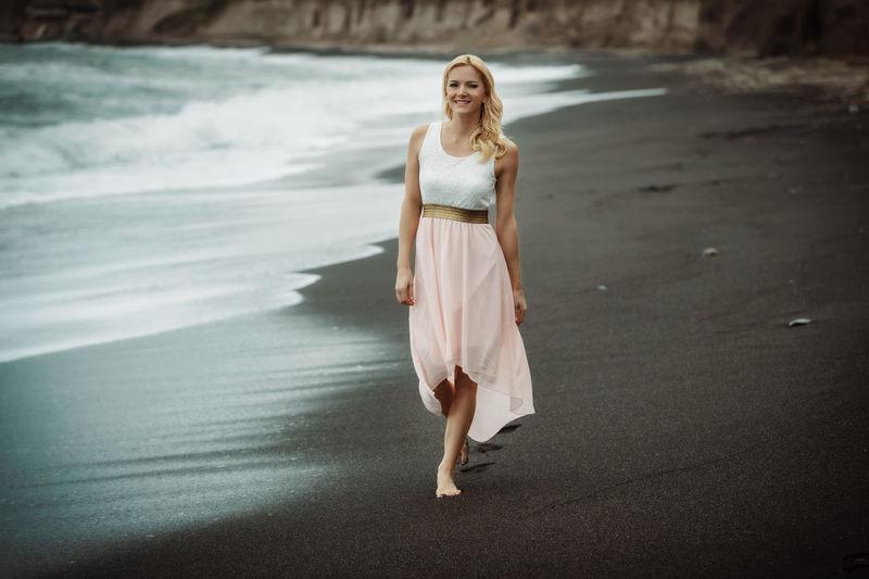 Full length portrait of woman at beach