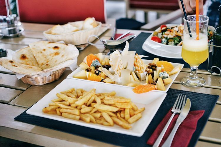 High Angle View Of Food And Drink Served On Table In Restaurant
