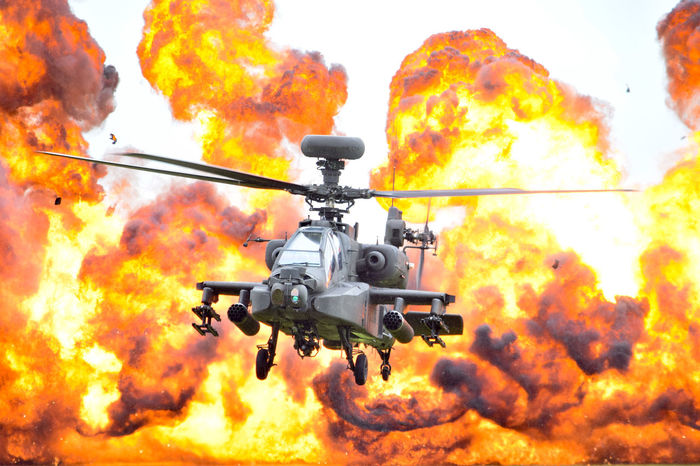 An Apache Attack Helicopter hooving in front of a massive explosion. I caught this shop at the AAC Middle Wallop Family Day - great display from the Apache guys. One amazing piece of machinery Military Technology Explosion Helicopter Apache Helicopter Apache Aac Army Army Air Corps Middle Wallop Nikonphotography Photooftheday Nikon Christiannicelphotography Air Vehicle War Military Aircraft