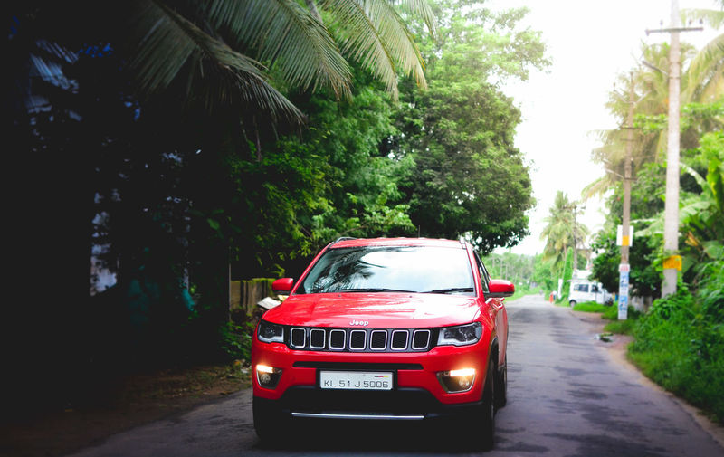 Red car on road in city