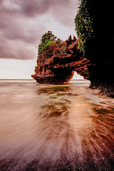 Take me back to this place Sunset Batu Bolong Temple Vitaminsea Batubolong Tanahlot, Bali, Indonesia Landscape_photography Landscape Bali, Indonesia Bali Rock Formation Sea Nature Beauty In Nature Rock - Object Water Sky Tranquility Cloud - Sky Natural Arch No People Outdoors