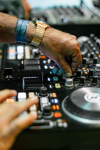 Cropped Hands Of People Mixing Music