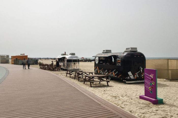 Jumeirah Beach. Dubai, UAE Beach Beach Food Beach Life Clear Sky Coast Coastline Day Dubai Emirates Food Truck Jumeirah Jumeirahbeach No People Outdoors Palm Trees Sand Sand & Sea Sea Sky Street Food Travel Travel Destinations Travel Photography Traveling UAE