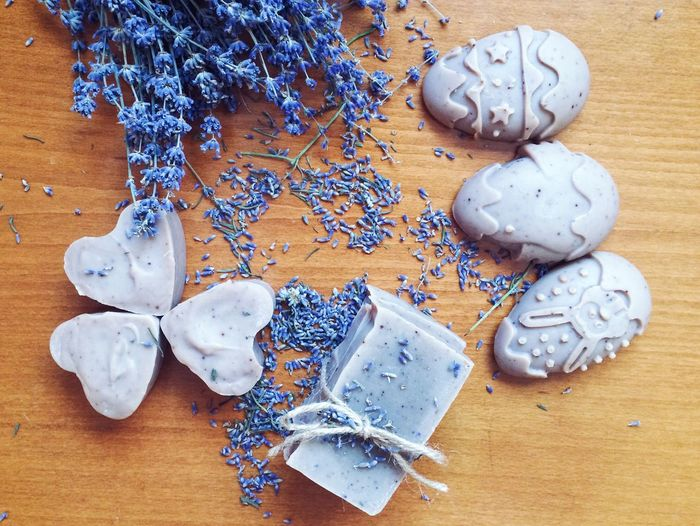 Directly above shot of homemade soaps with lavenders on table