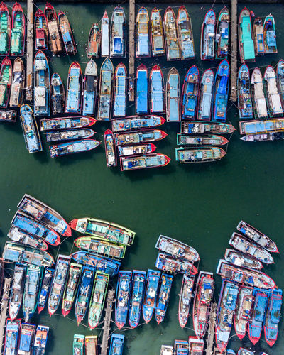 Stack of multi colored boats in canal